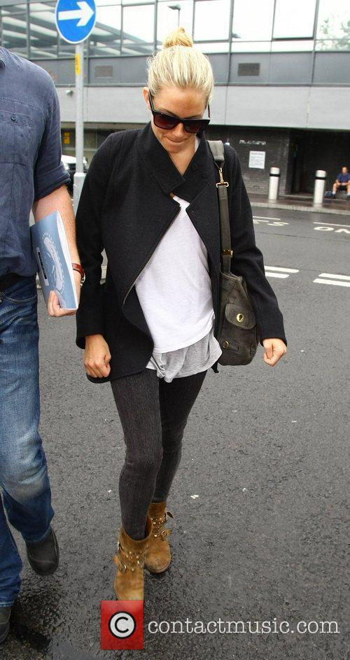 Sienna Miller arrives at Heathrow Airport on a...