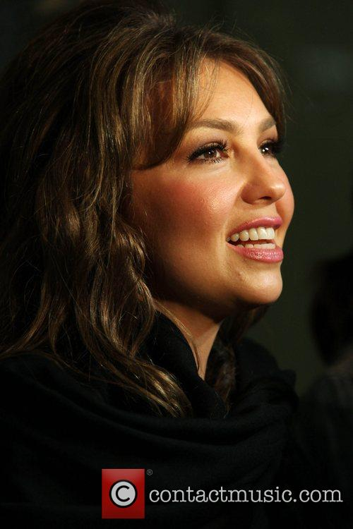 Mexican pop singer, Thalia surrounded by press while...
