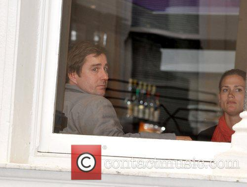 Luke Wilson enjoys a drink with a friend...