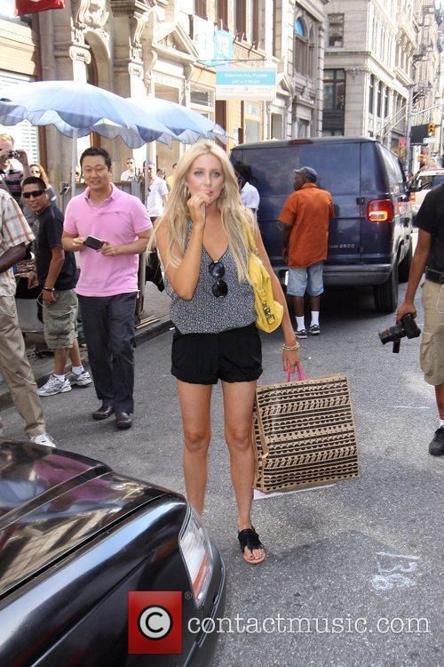Stephanie Pratt of The Hills surrounded by paparazzi...