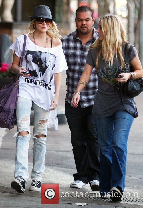Stephanie Pratt, wearing ripped jeans and an oversized...
