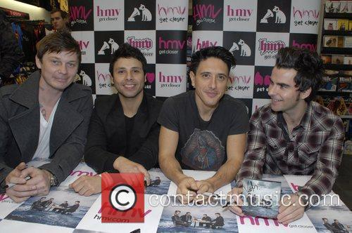 Promoting and signing copies of their new album...
