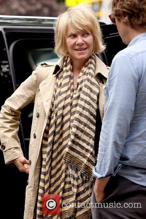 Out and about in Soho with her husband