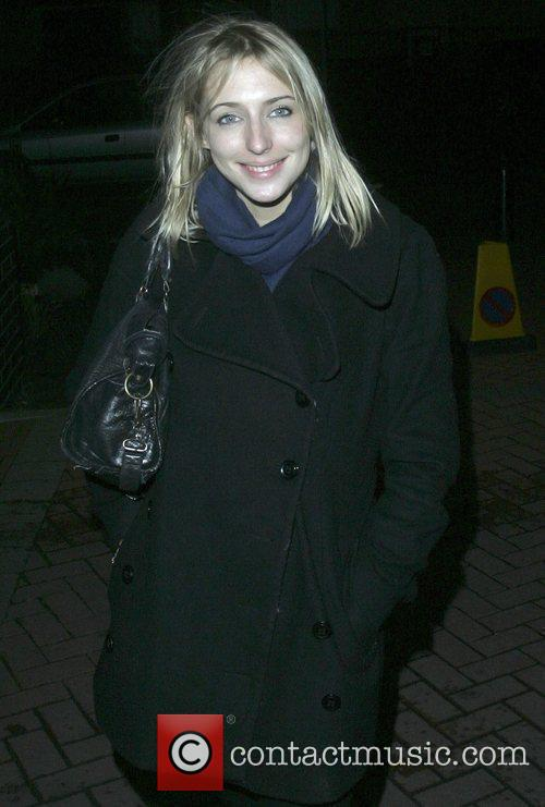Ali Bastian arrives at her hotel after rehearsing...