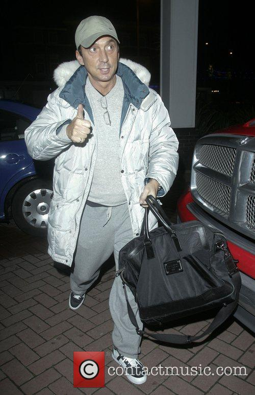 Arrives at his hotel after rehearsing for 'Strictly...