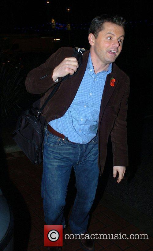 Chris Hollins arrives back at his hotel after...