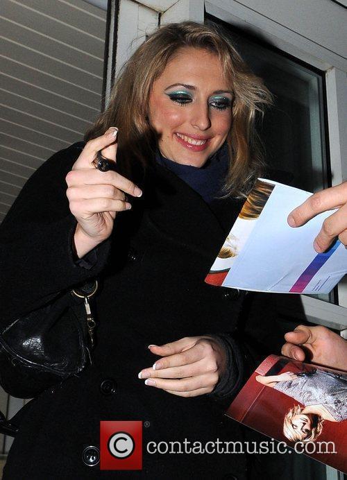 Ali Bastian arrives back at her hotel after...