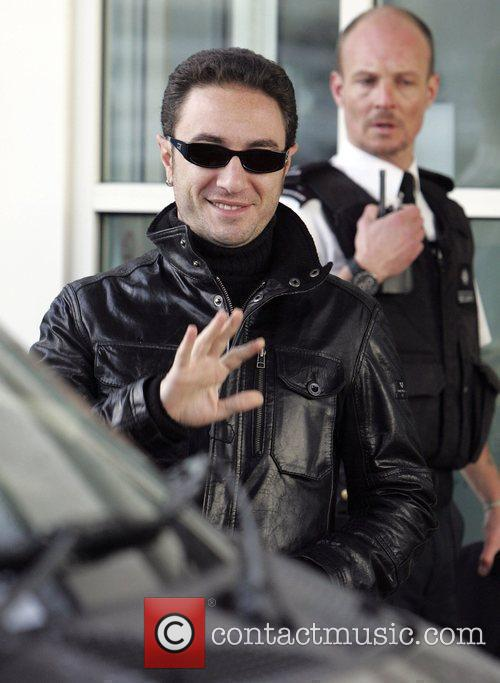 Vincent Simone leaves his hotel to head to...