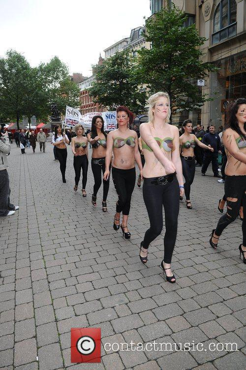 Women With Painted-on Camouflage Bras Collect Money For The Support Our Soldiers (sos) Charity 2