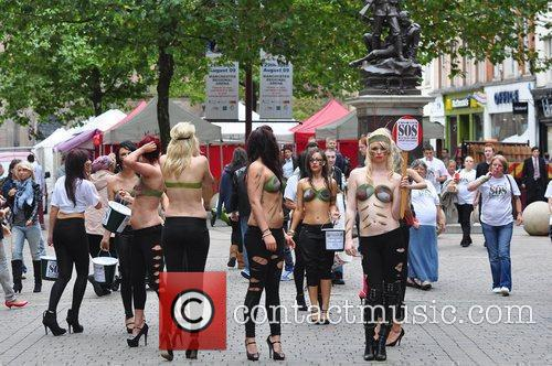 Women With Painted-on Camouflage Bras Collect Money For The Support Our Soldiers (sos) Charity 6