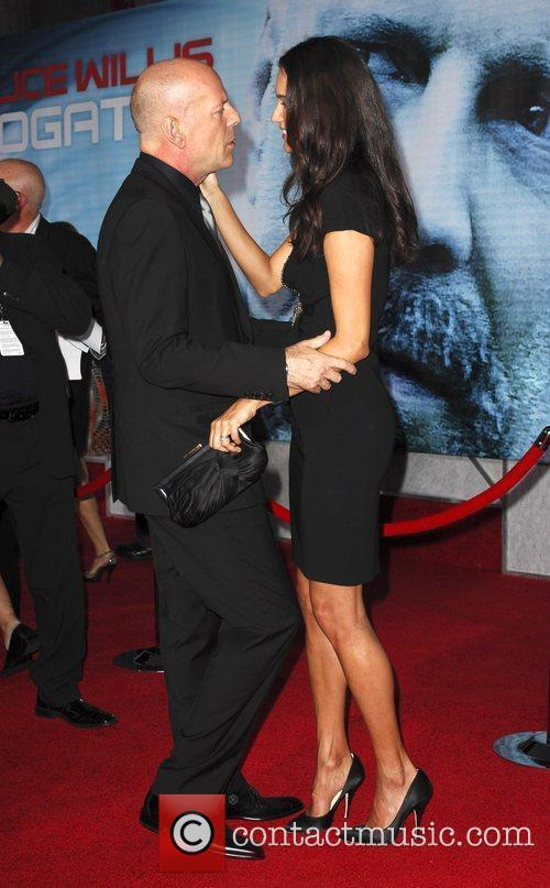 Bruce Willis and Emma Heming The Surrogates premiere...