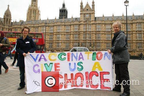 Demonstrators Protest Outside The Houses Of Parliament Over Plans To Enforce A Mandatory Vaccination For Swine Flu 2