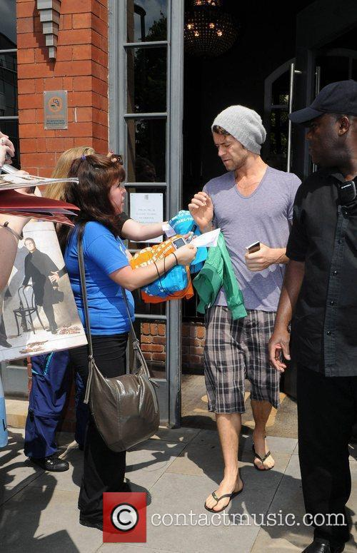 Howard Donald leaving his hotel and heads to...