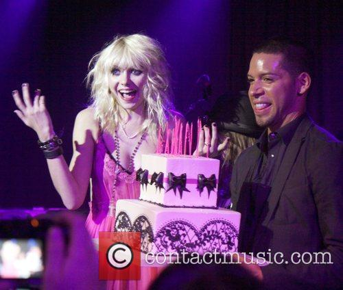 Taylor Momsen  blows out candles for her...