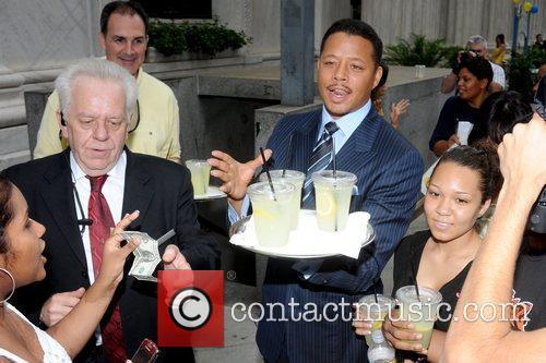 Sells lemonade outside of the Ritz-Carlton to raise...