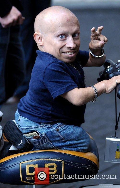 Verne Troyer rides on his pimped mobility scooter...