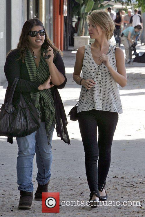 Audrina Patridge talking to a friend outside the...