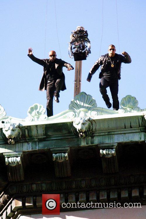 Stuntmen Suspended On Wires 4