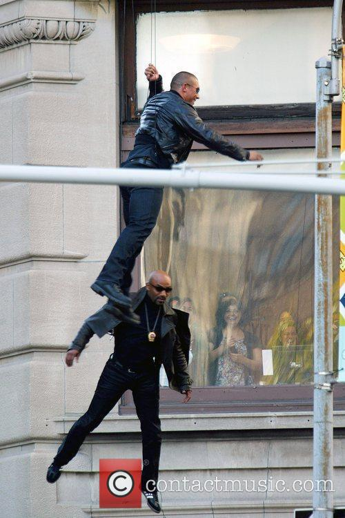 Stuntmen Suspended On Wires 6