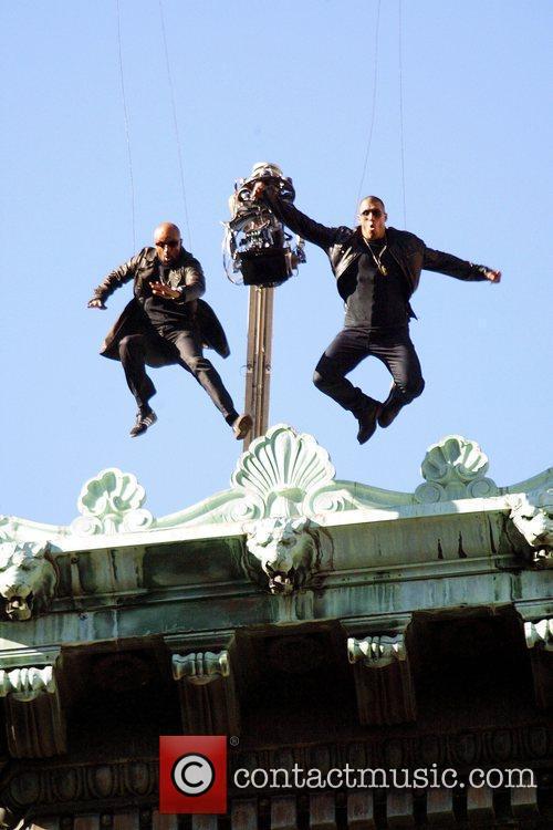 Stuntmen Suspended On Wires 5