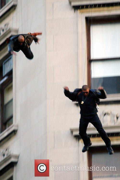 Stuntmen Suspended On Wires 3