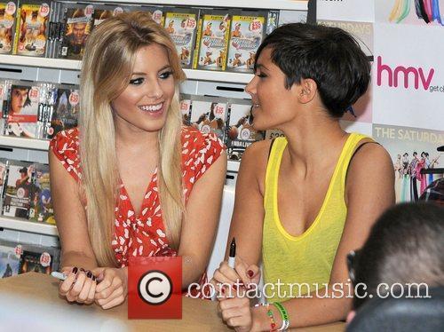 The Saturdays - Mollie, Vanessa signing copies of...