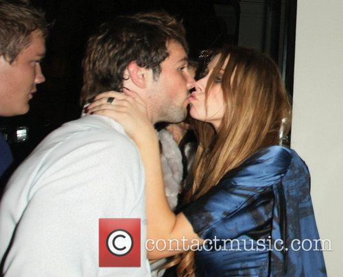 Una Healy and boyfriend Ben Foden kiss whilst...