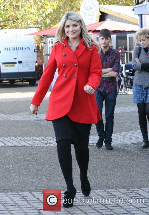 Holly Willoughby  outside to present a segment...