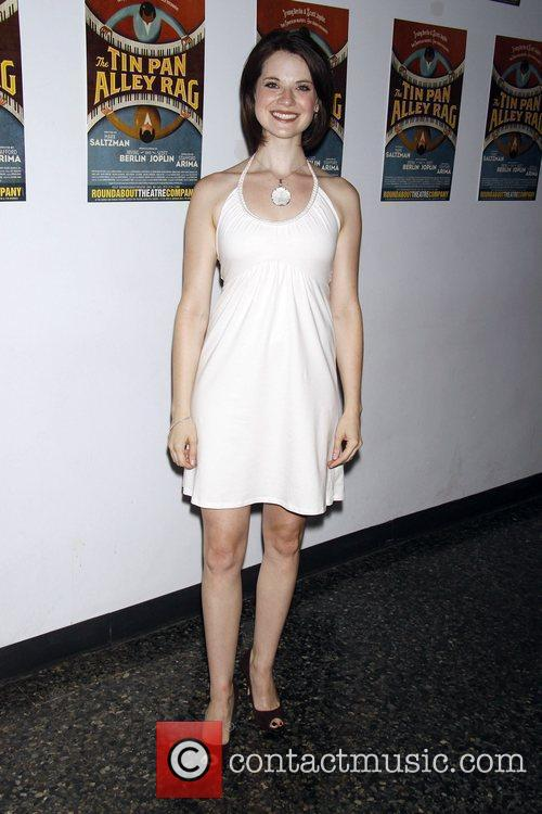 Attends the post show photocall for the cast...
