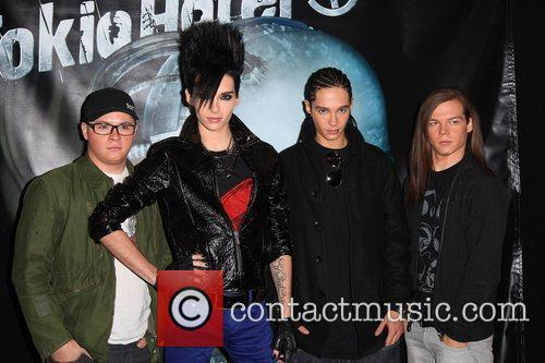 Tokio Hotel sign copies of their new CD...