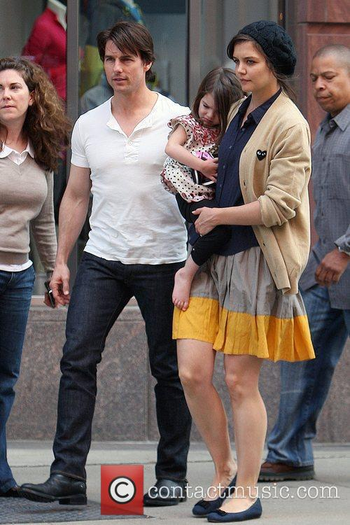 With their daughter Suri leaving the Nike store
