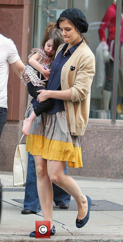 Tom Cruise, Katie Holmes with their daughter Suri...
