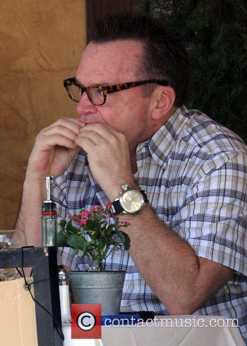Tom Arnold enjoys lunch with a friend in...