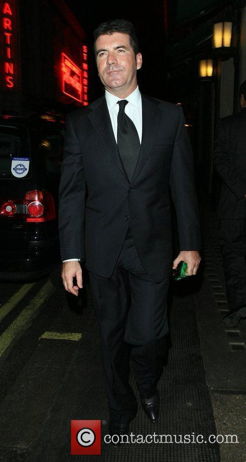 Simon Cowell leaves the Topshop London Fashion Show...
