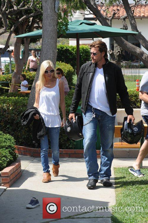 Tori Spelling and Dean Mcdermott Carrying Motorcycle Helmets At Malibu Country Mart 2
