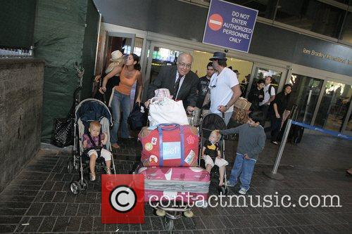 Tori Spelling, Dean Mcdermott Arrive At Tom Bradley International Terminal At Lax Airport With Their Children Liam and Stella 7