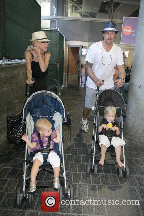 Tori Spelling, Dean McDermott arrive at Tom Bradley International Terminal at LAX airport with their children Liam and Stella 10