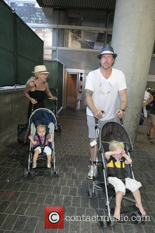 Tori Spelling, Dean McDermott arrive at Tom Bradley International Terminal at LAX airport with their children Liam and Stella 6
