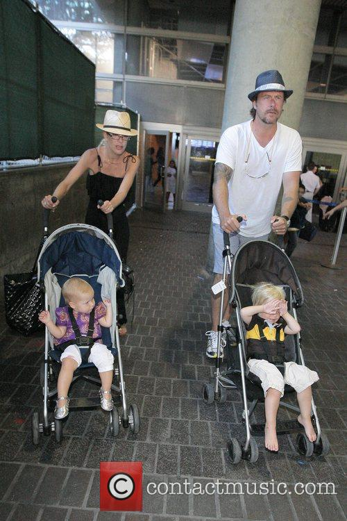 Tori Spelling, Dean McDermott arrive at Tom Bradley International Terminal at LAX airport with their children Liam and Stella 15