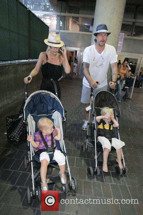 Tori Spelling, Dean McDermott arrive at Tom Bradley International Terminal at LAX airport with their children Liam and Stella 9