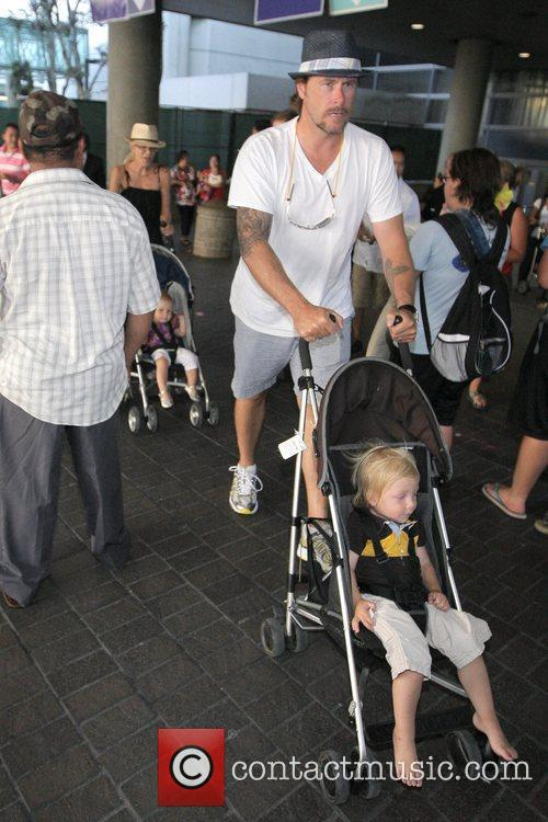 Tori Spelling, Dean McDermott arrive at Tom Bradley International Terminal at LAX airport with their children Liam and Stella 14