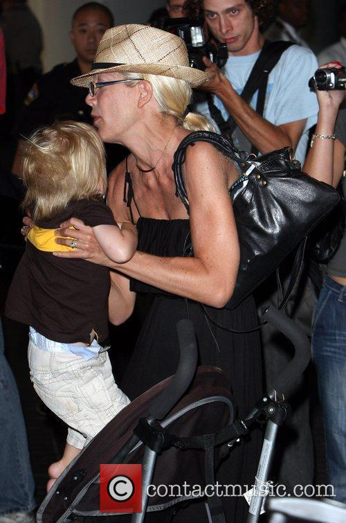 Tori Spelling, Dean McDermott arrive at Tom Bradley International Terminal at LAX airport with their children Liam and Stella 19