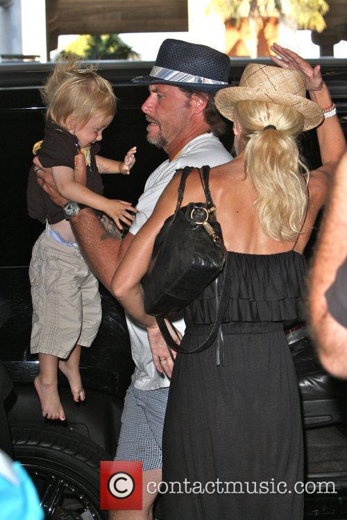 Tori Spelling, Dean McDermott arrive at Tom Bradley International Terminal at LAX airport with their children Liam and Stella 25