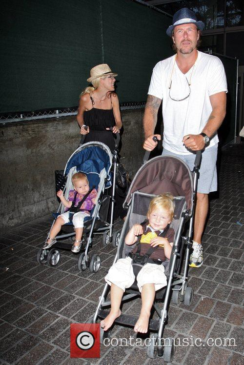 Tori Spelling, Dean McDermott arrive at Tom Bradley International Terminal at LAX airport with their children Liam and Stella 24