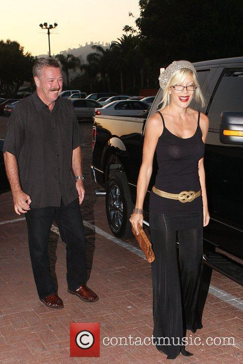 Tori Spelling and her husband Dean's father arrive...