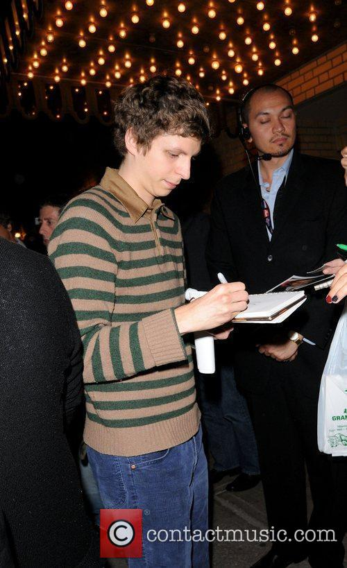Signs autographs during the 2009 Toronto Film Festival