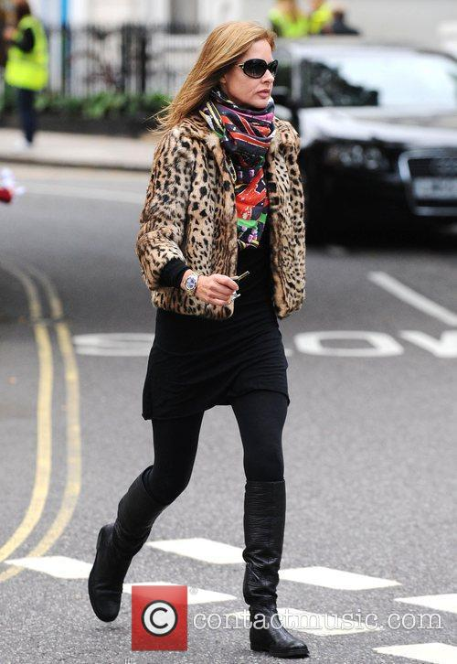 Trinny Woodall heads back to her car after...