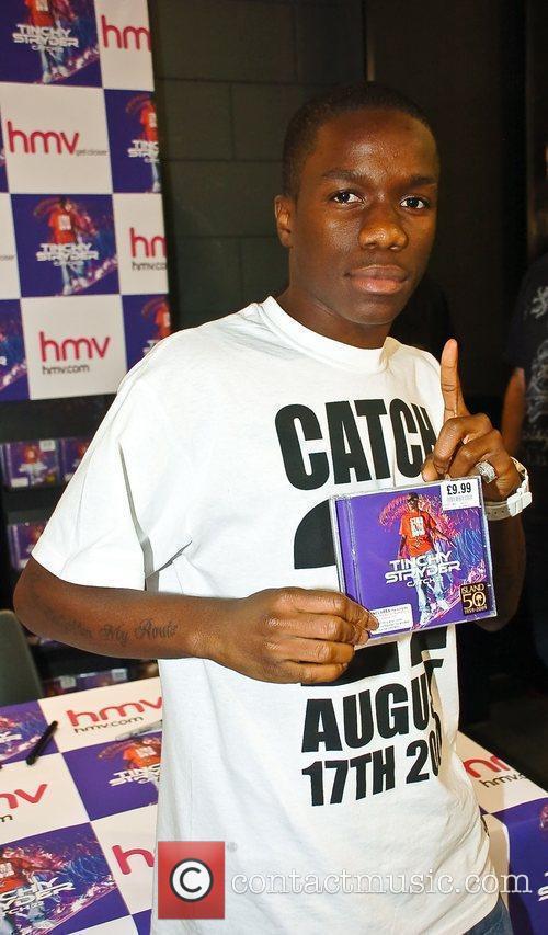 Signs copies of his new album at HMV...