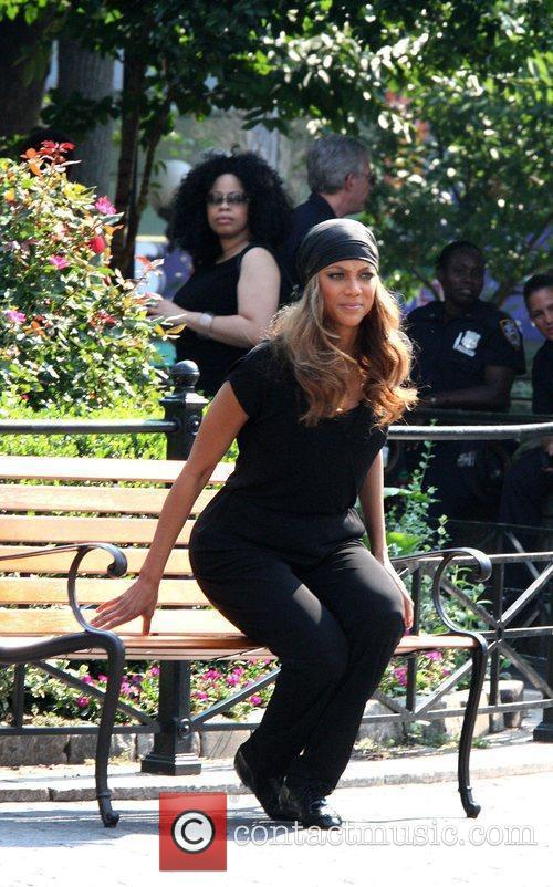 Tyra Banks takes a break from filming for...