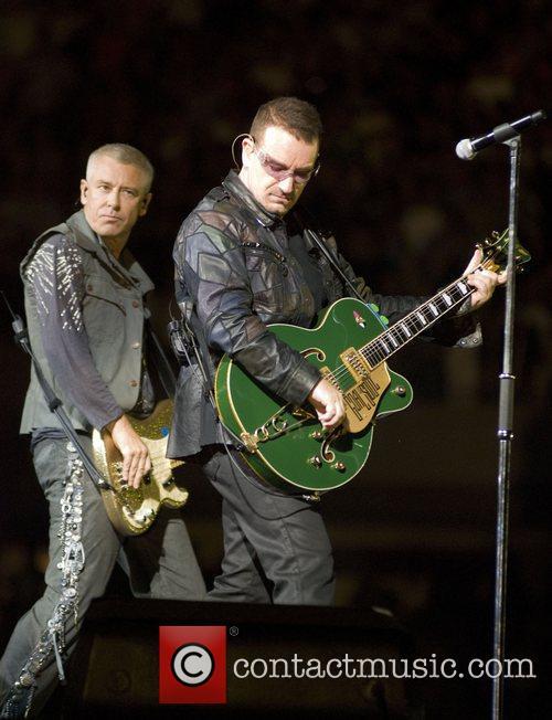 Adam Clayton, Bono U2 performing live on their...